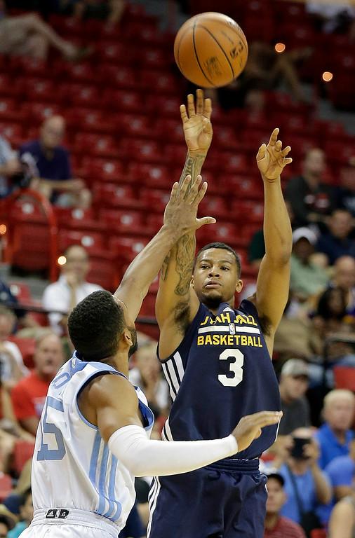 . Denver Nuggets\' Carlon Brown (15) covers a shot from Utah Jazz\'s Trey Burke (3) during the first half of an NBA summer league basketball game Tuesday, July 15, 2014, in Las Vegas. (AP Photo/Isaac Brekken)