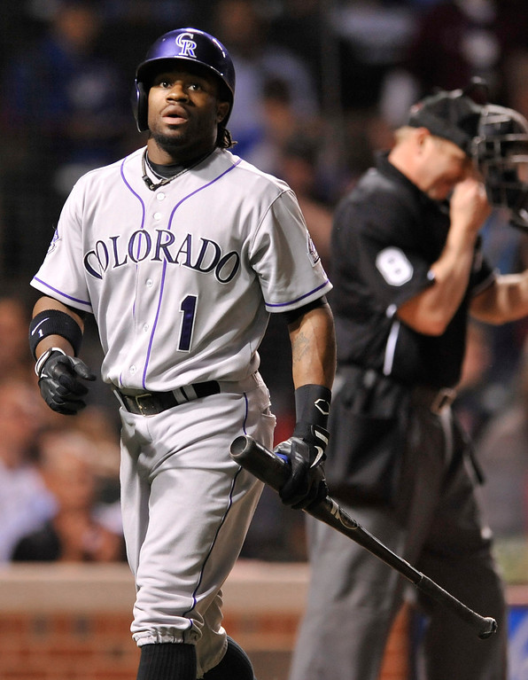 . Colorado Rockies\' Eric Young Jr.,left, looks on after striking out during the eighth inning of a baseball game against the Chicago Cubs in Chicago, Wednesday, May 15, 2013. Chicago won 6-3. (AP Photo/Paul Beaty)