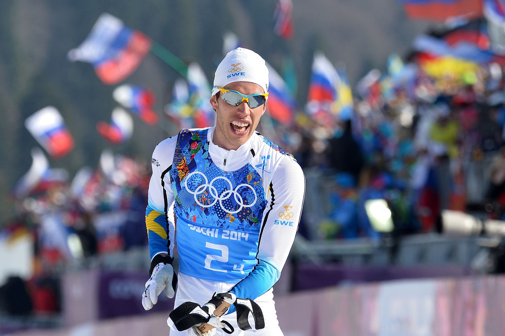 . Sweden\'s Marcus Hellner celebrates as he crosses the finish line to win with his team the gold medal in the Men\'s Cross-Country Skiing 4 x 10km Relay at the Laura Cross-Country Ski and Biathlon Center during the Sochi Winter Olympics on February 16, 2014 in Rosa Khutor near Sochi. ALBERTO PIZZOLI/AFP/Getty Images