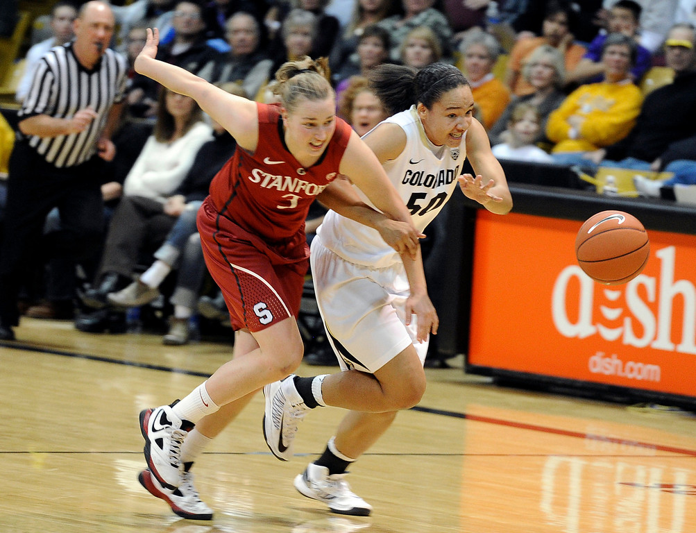 . University of Colorado\'s Jamee Swan fights for a loose ball with Mikaela Ruef during a game against Stanford on Friday, Jan. 4, at the Coors Event Center on the CU campus in Boulder.    Jeremy Papasso/Camera
