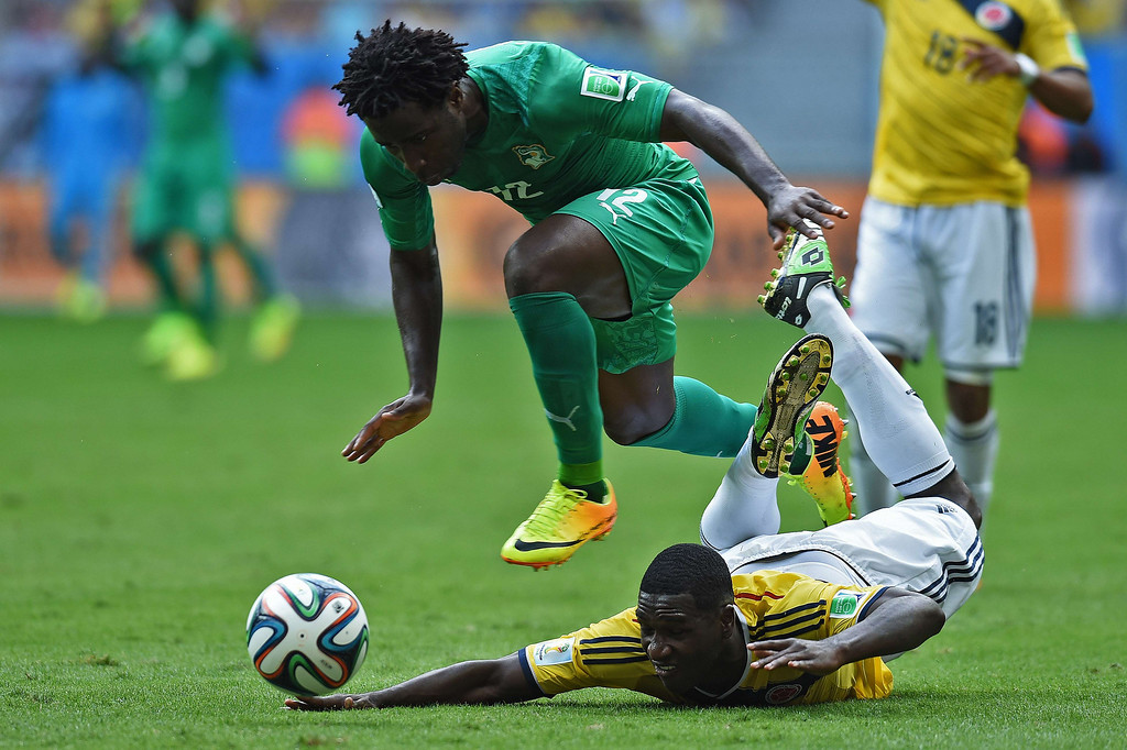 . Colombia\'s defender Cristian Zapata (R) is fouled by Ivory Coast\'s forward Wilfried Bony during the Group C football match between Colombia and Ivory Coast at the Mane Garrincha National Stadium in Brasilia during the 2014 FIFA World Cup on June 19, 2014.  PEDRO UGARTE/AFP/Getty Images