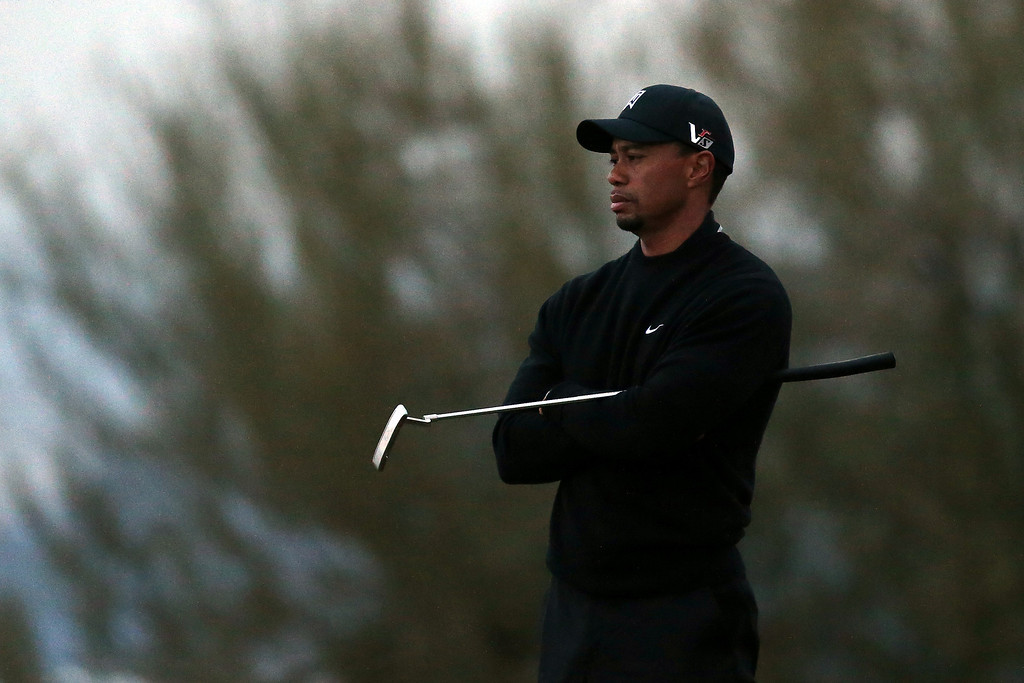 . MARANA, AZ - FEBRUARY 21:  Tiger Woods looks on from the 17th green during the first round of the World Golf Championships - Accenture Match Play at the Golf Club at Dove Mountain on February 21, 2013 in Marana, Arizona. Round one play was suspended on February 20 due to inclimate weather and is scheduled to be continued today.  (Photo by Jed Jacobsohn/Getty Images)