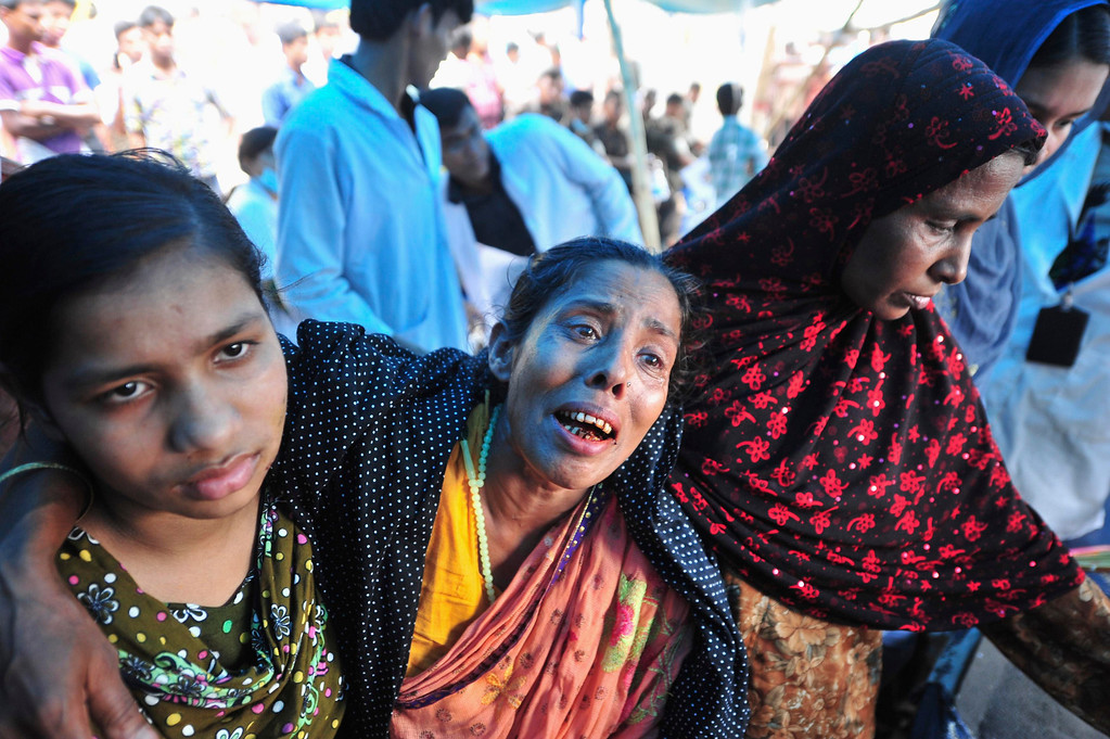 . Women mourn for their relatives, garment workers who had died in the collapse of the Rana Plaza building, in Savar, around 30 km (19 miles) outside Dhaka April 30, 2013.   REUTERS/Khurshed Rinku