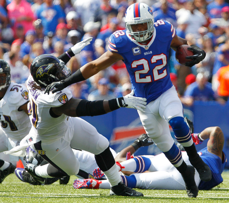 . Buffalo Bills running back Fred Jackson (22) runs past Baltimore Ravens outside linebacker Courtney Upshaw (91) during the first half of an NFL football game on Sunday, Sept. 29, 2013, in Orchard Park, N.Y. (AP Photo/Bill Wippert)