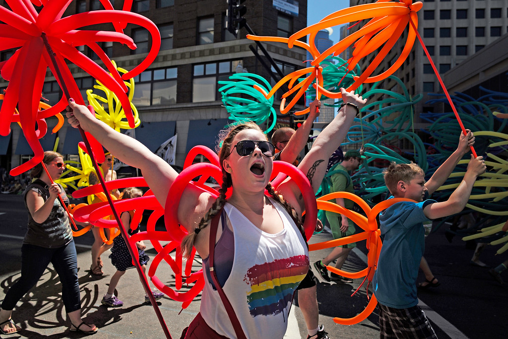 . Tiffany Ashmead partakes in the 2014 Ashley Rukes GLBT Pride Parade in downtown Minneapolis on Sunday, June 29, 2014. She is a baker at Angel Food Bakery and Coffee Bar. (AP Photo/Minneapolis Star Tribune, Richard Tsong-Taatarii)