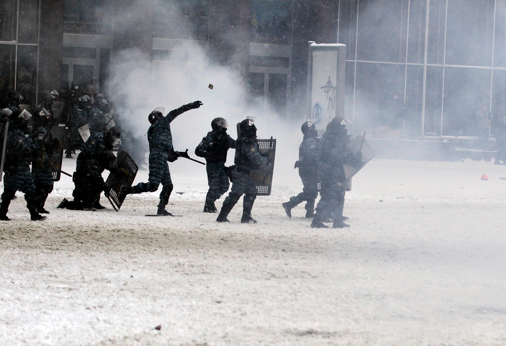 . Police clash with protesters in central Kiev, Ukraine, Wednesday, Jan. 22, 2014. (AP Photo/Darko Vojinovic)