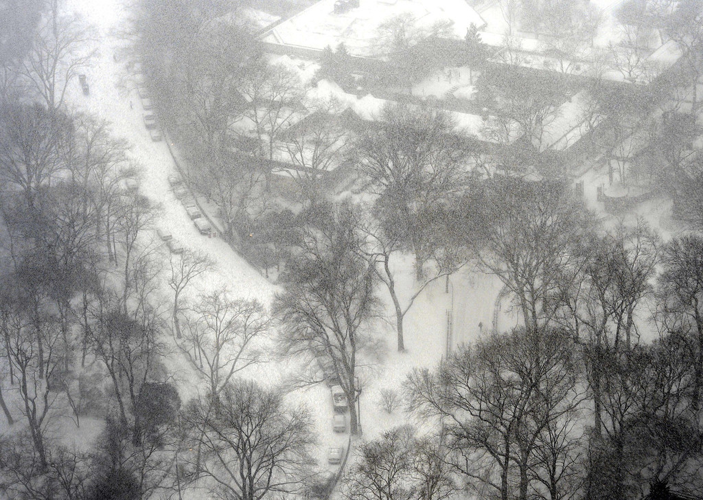 . A view of Central Park in the snow as New Yorkers get hit with a  winter storm in the Northeast January 21, 2014  that could bring up to a foot (30 cm) of snow in the city.  AFP PHOTO / TIMOTHY A. CLARY/AFP/Getty Images