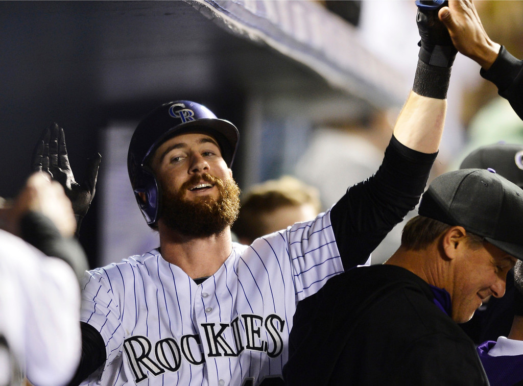 . Colorado Rockies\' Charlie Blackmon celebrates a home run against the New York Mets during the seventh inning of a baseball game, Friday, May 2, 2014, in Denver. (AP Photo/Jack Dempsey)