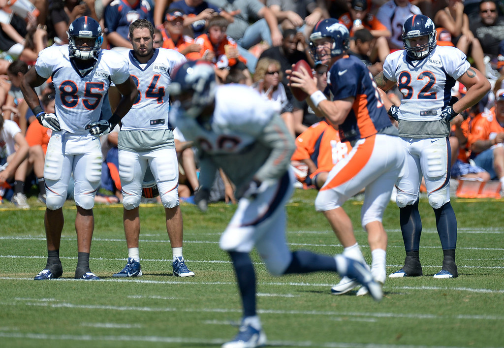 . Denver Broncos TE Virgil Green (85) Jacob Tamme (84) Jake O\'Connell (82) watch QB Peyton Manning (18) run the offense with TE Julius Thomas running his route during training camp August 5, 2013 at Dove Valley. (Photo By John Leyba/The Denver Post)