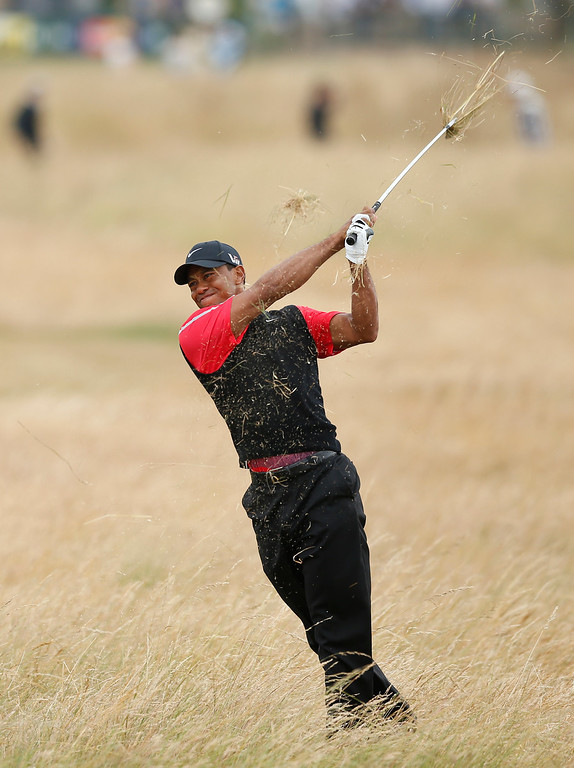. Tiger Woods of the United States plays a shot on the 10th hole during the final round of the British Open Golf Championship at Muirfield, Scotland, Sunday July 21, 2013. (AP Photo/Matt Dunham)