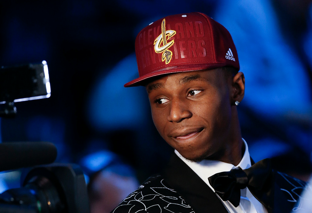 . Andrew Wiggins of Kansas stops for a television interview after being selected by the Cleveland Cavaliers as the number one pick in the 2014 NBA draft, Thursday, June 26, 2014, in New York. (AP Photo/Kathy Willens)
