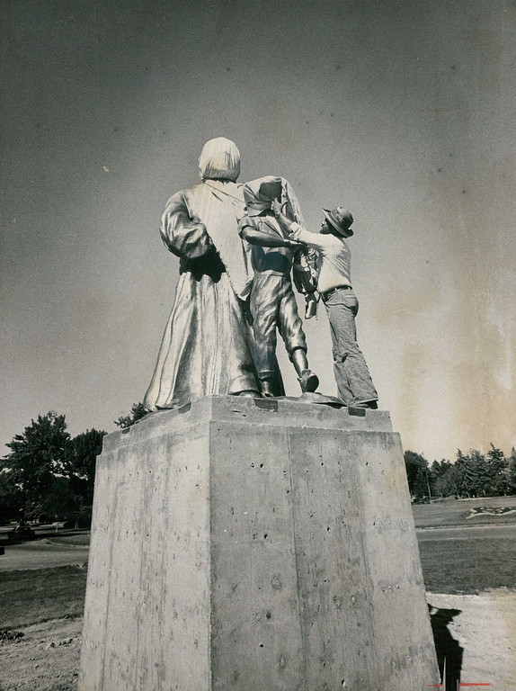 . SEP 4 1976. Statues Prepared For Dedication Ceremonies. Bronze statues in City Park are prepared for dedication at 1:30 p.m. Sunday. The statues are of the late Dr. Martin Luther King and Emmett Till, a 14- year-old black youth who was lynched near Money, Miss., in 1955 purportedly for whistling at a white woman. Derek King, a nephew of the slain civil rights leader, and Mrs. Mamie Mobley, Till\'s mother, will attend the ceremonies, to be held in the southwest corner of the park. Numerous Denver civil and political leaders also will be on hand for the dedication rites.   (David Cupp/Denver Post, Inc)