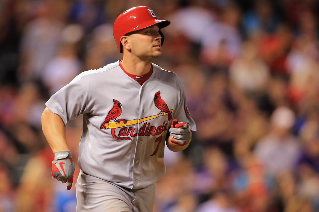 . Matt Holliday #7 of the St. Louis Cardinals rounds the bases on his two run homerun off of Rob Scahill #62 of the Colorado Rockies to give the Cards a 10-0 lead in the fifth inning at Coors Field on September 17, 2013 in Denver, Colorado.  (Photo by Doug Pensinger/Getty Images)
