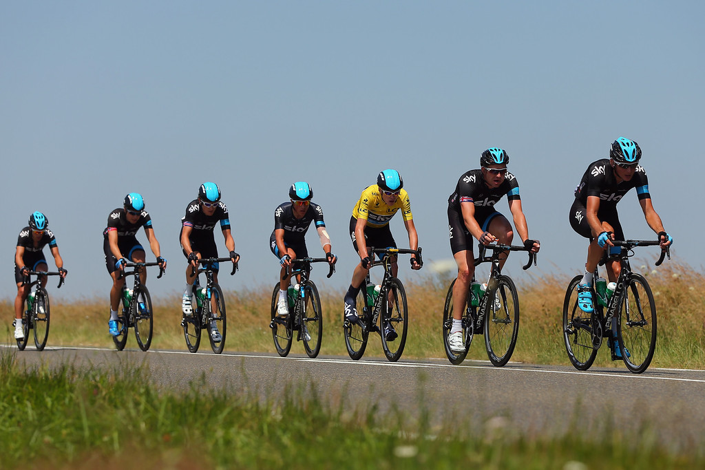 . TOURS, FRANCE - JULY 11: (L-R) Richie Porte, Edvald Boassan Hagen, Geraint Thomas, Peter Kennaugh, race leader Chris Froome, Ian Stannard and Kanstantsin Siutsou of Team SKY Procycling ride in the peloton during stage twelve of the 2013 Tour de France, a 218KM road stage from Fougeres to Tours, on July 11, 2013 in Tours, France.  (Photo by Bryn Lennon/Getty Images)