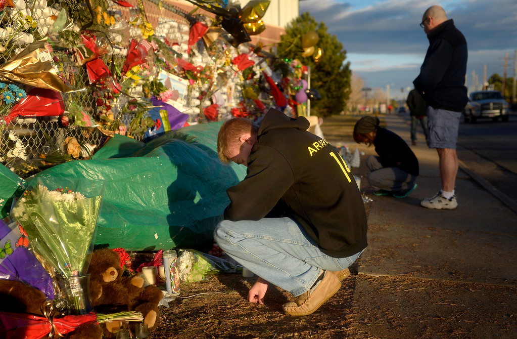 . Matthew Bush, a senior at Arapahoe High School who knew shooting victim Claire Davis, mourns the 17-year-old student\'s death on Dec. 22 near a memorial outside Arapahoe High School in Centennial. Photo by Jamie Cotten, Special to The Denver Post