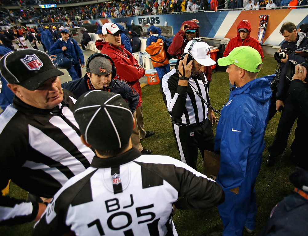 . Referees confer on a suspension of the game between the Chicago Bears and the Baltimore Ravens due to weather at Soldier Field on November 17, 2013 in Chicago, Illinois. A fast-moving storm system that produced at least one tornado in Illinois has suspended the game and forced fans to evacuate. (Photo by Jonathan Daniel/Getty Images)