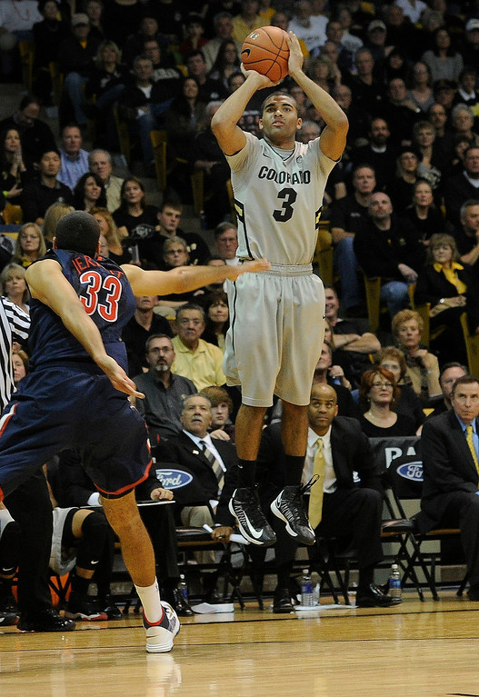 . BOULDER, CO. - FEBRUARY 14: Colorado Buffaloes guard Xavier Talton (3) drained a three-point shot late in the second half. The University of Colorado men\'s basketball team defeated Arizona 71-58 Thursday night, February 14, 2013 at the Coors Event Center in Boulder. (Photo By Karl Gehring/The Denver Post)