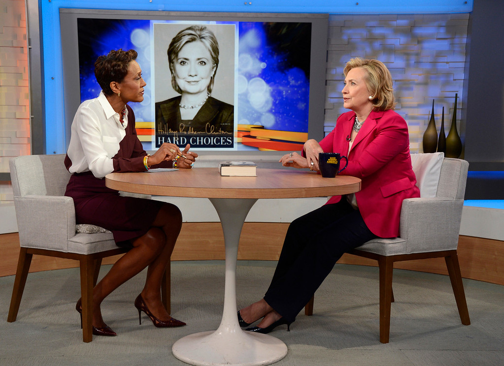 """. In this photo provided by the American Broadcasting Companies, Inc., former Secretary of State Hillary Rodham Clinton, right, discusses her new memoir, \""""Hard Choices\"""" with Robin Roberts during a live interview with Roberts on the ABC Television Network\'s \""""Good Morning America,\"""" Tuesday, June 10, 2014 in New York.  (AP Photo/ABC, Ida Mae Astute)"""
