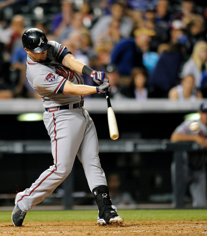 . Atlanta Braves Chris Johnson hits an RBI single in the eighth inning of a baseball game against the Colorado Rockies on Monday, June 9, 2014, in Denver. (AP Photo/Chris Schneider)
