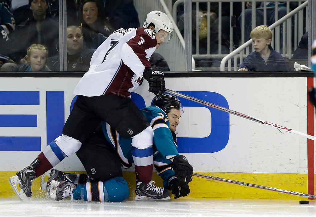 . Colorado Avalanche center John Mitchell (7) collides against the boards with San Jose Sharks left wing T.J. Galiardi (21) during the third period of an NHL hockey game in San Jose, Calif., Saturday, Jan. 26, 2013. San Jose won- 4-0.  (AP Photo/Marcio Jose Sanchez)
