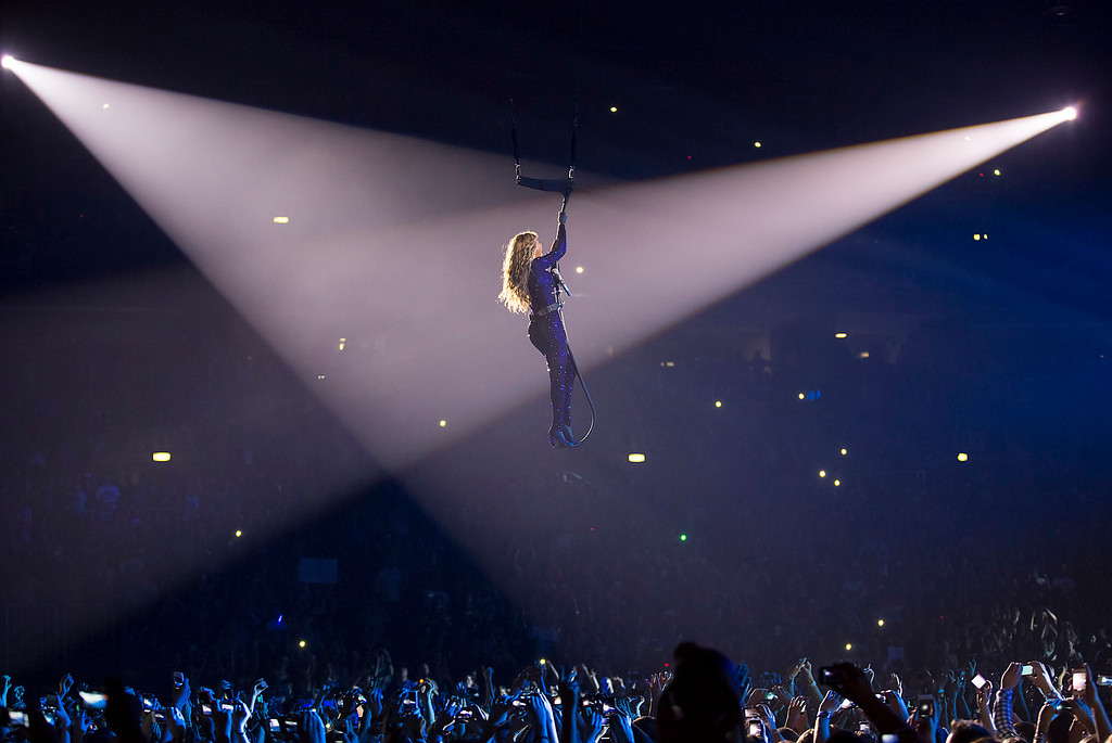 """. Singer Beyonce performs on her \""""Mrs. Carter Show World Tour 2013\"""", on Wednesday, April 17, 2013 at the Arena Zagreb in Zagreb, Croatia. Beyonce is wearing a cobalt blue hand beaded jumpsuit by designer Vrettos Vrettakos. (Photo by Yosra El-Essawy/Invision for Parkwood Entertainment/AP Images."""