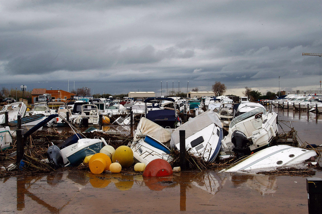 . Motor boats lie wrecked in the port of La Londe Les Maures, near Toulon, southern France, Monday, Jan. 20, 2014, after unusually heavy rains flooded the French Riviera, leaving two people dead and some thousands without electricity or access to roads. The administration for the Var region evacuated some residents and urged others to stay indoors until the waters recede.(AP Photo/Claude Paris)