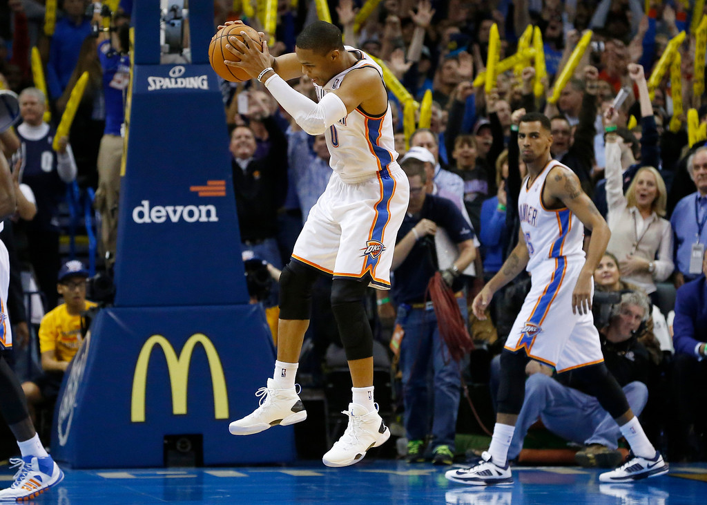 . Oklahoma City Thunder guard Russell Westbrook (0) grabs the final rebound as the game against the NBA basketball game Denver Nuggets ends in Oklahoma City, Monday, Nov. 18, 2013. Oklahoma City won 115-113. (AP Photo/Sue Ogrocki)