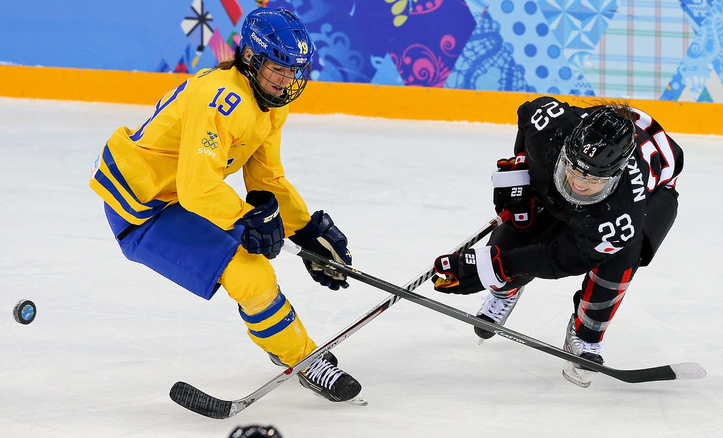 . Ami Nakamura (R) of Japan in action against Maria Lindh (L) of Sweden  during the match between Sweden and Japan at the Shayba Arena in the Ice Hockey tournament at the Sochi 2014 Olympic Games, Sochi, Russia, 09 February 2014  EPA/SRDJAN SUKI