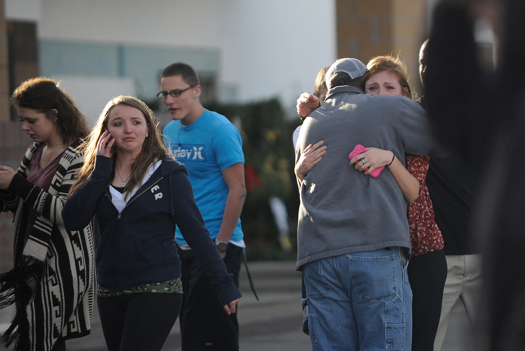 . LITTLETON, CO - DECEMBER 13 : At the school shooting at Arapahoe High School in Littleton, CO  on Friday, December 13, 2013  Chris Foster hugs his daughter Devan Foster a senior after they reunited at the Kings Sooper parking lot. (Photo By Cyrus McCrimmon/The Denver Post)
