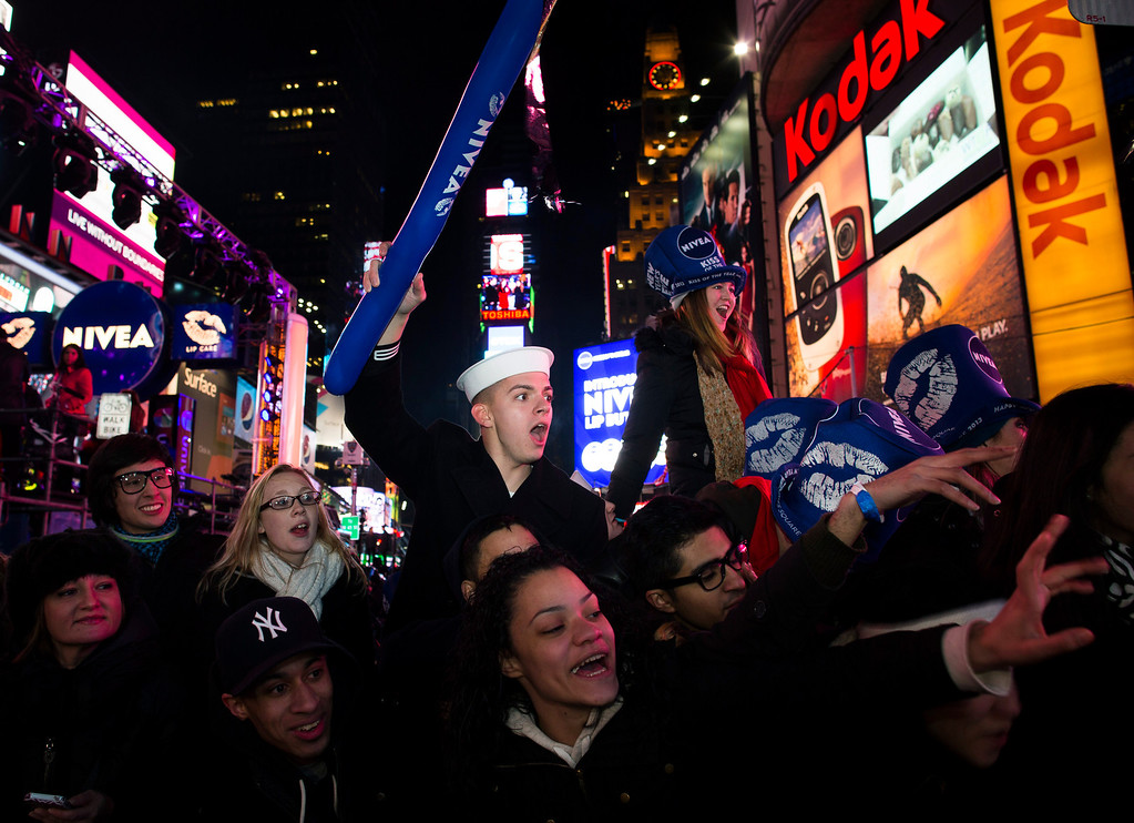 . Revelers cheer in Times Square at the New Year\'s Eve celebration, Monday, Dec. 31, 2012, in New York. (AP Photo/John Minchillo)
