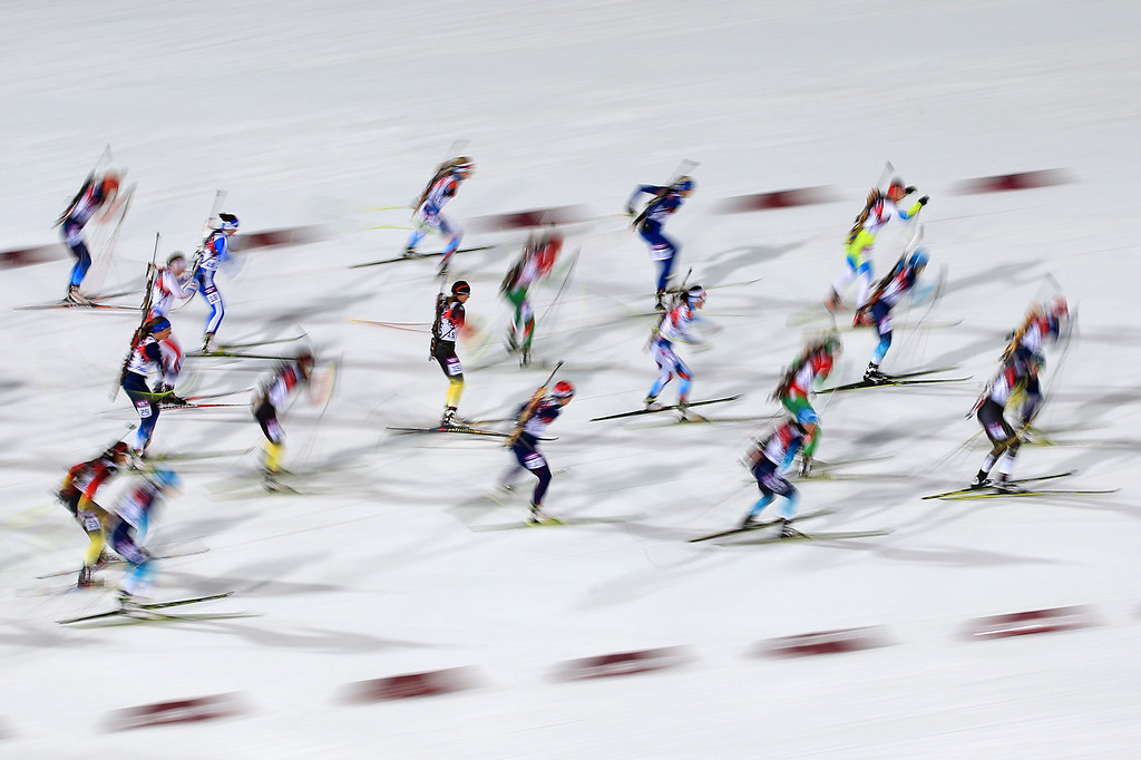 . Athletes compete in the Women\'s 12.5 km Mass Start during day ten of the Sochi 2014 Winter Olympics at Laura Cross-country Ski & Biathlon Center on February 17, 2014 in Sochi, Russia.  (Photo by Richard Heathcote/Getty Images)