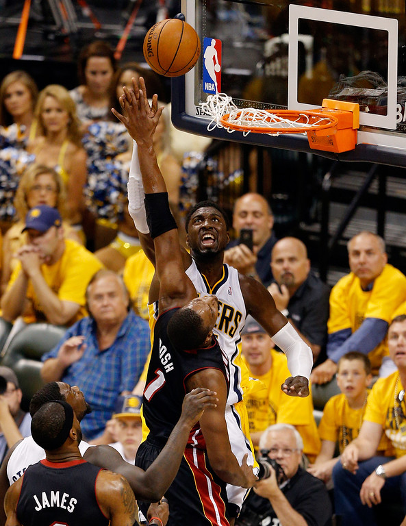 . INDIANAPOLIS, IN - MAY 28:  Roy Hibbert #55 of the Indiana Pacers goes to the basket as Chris Bosh #1 of the Miami Heat defends during Game Five of the Eastern Conference Finals of the 2014 NBA Playoffs at Bankers Life Fieldhouse on May 28, 2014 in Indianapolis, Indiana.  (Photo by Joe Robbins/Getty Images)