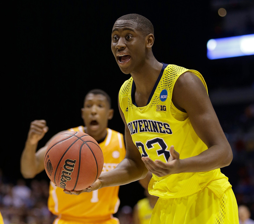 . Michigan\'s Caris LeVert reacts to a call during the second half of an NCAA Midwest Regional semifinal college basketball tournament game against the Tennessee Friday, March 28, 2014, in Indianapolis. (AP Photo/David J. Phillip)