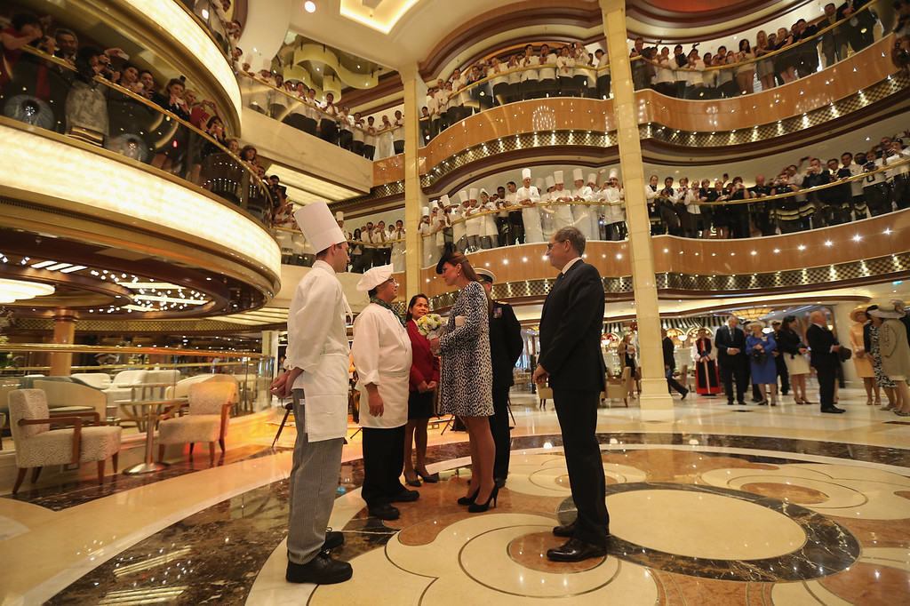 . Crew look on as Captain Tony Draper (2nd-L) gives Catherine, Duchess of Cambridge a tour on board the Princess Cruises ship during its naming ceremony at Ocean Terminal on June 13, 2013 in Southampton, England.  (Photo by Chris Jackson- WPA Pool/Getty Images)