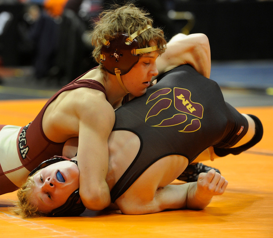 . DENVER, CO. - FEBRUARY 21: Ponderosa High School sophomore Kade Snyder, top, rolled Rocky Mountain junior Logan Newmann, bottom, during a 113-pound bout in class 5A. The CHSAA State Wrestling Tournament kicked off Thursday, February 21, 2013 at the Pepsi Center in Denver.    (Photo By Karl Gehring/The Denver Post)
