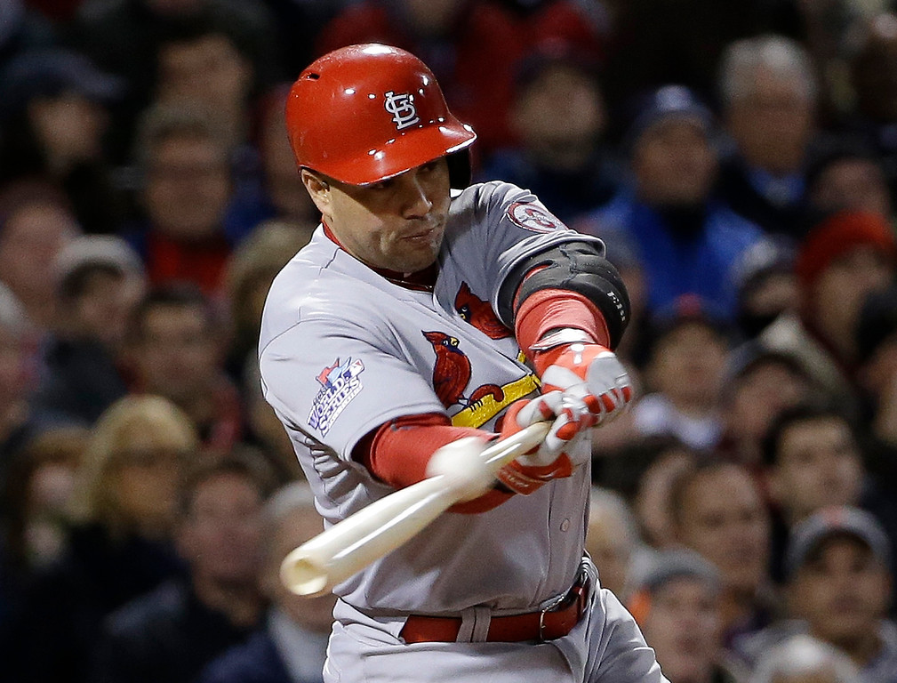 . St. Louis Cardinals\' Carlos Beltran hits an RBI single during the seventh inning of Game 2 of baseball\'s World Series against the Boston Red Sox Thursday, Oct. 24, 2013, in Boston. (AP Photo/David J. Phillip)