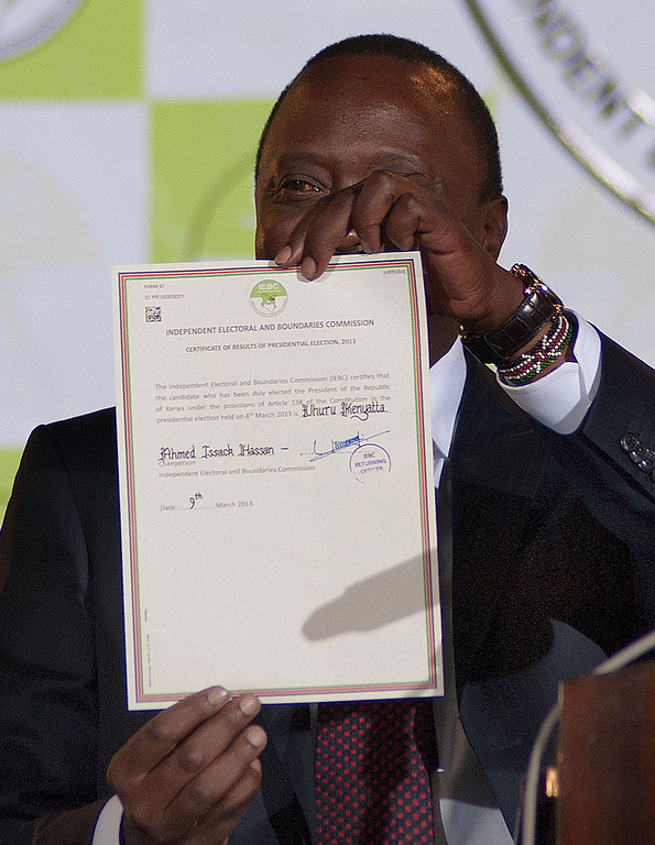 . Uhuru Kenyatta shows the certificate confirming him as Kenya\'s new President elect delivered by Isaack Hassan, Chairman of the Independent Electoral and Boundaries Commission (IEBC) at Bomas, in Nairobi, on March 9, 2013. Uhuru emerged as winner of the 2013 general election by a slim margin, and the opposing CORD Coalition have said they will contest the result.    AFP PHOTO / WILL  Boase/AFP/Getty Images