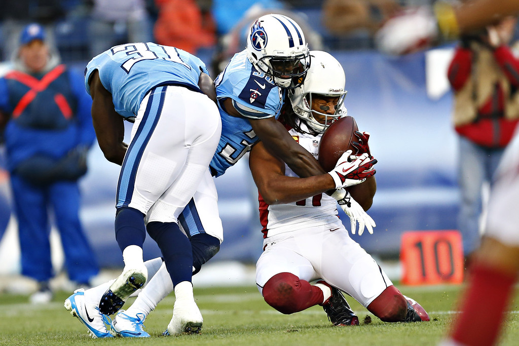 Description of . Larry Fitzgerald #11 of the Arizona Cardinals has the pass knocked away by Jason McCourty #30 of the Tennessee Titans at LP Field on December 15, 2013 in Nashville, Tennessee.  (Photo by Wesley Hitt/Getty Images)