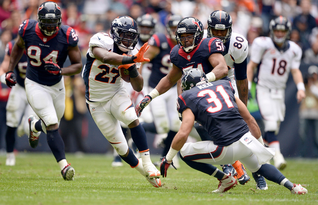 . HOUSTON, TX - DECEMBER 22: Denver Broncos running back Knowshon Moreno (27) picks up a big gain as ,h31 comes in for the tackle during the first quarter December 22, 2013 at Reliant Stadium. (Photo by John Leyba/The Denver Post)
