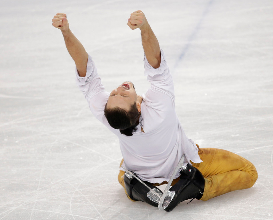 . Fedor Klimov reacts after he and Ksenia Stolbova of Russia completed their routine in the pairs free skate figure skating competition at the Iceberg Skating Palace during the 2014 Winter Olympics, Wednesday, Feb. 12, 2014, in Sochi, Russia. (AP Photo/Bernat Armangue)