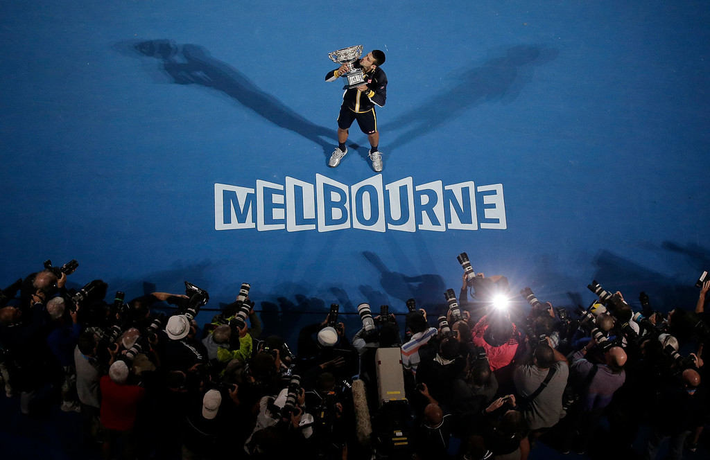 . Serbia\'s Novak Djokovic holds his trophy after defeating Britain\'s Andy Murray in the men\'s final at the Australian Open tennis championship in Melbourne, Australia, Sunday, Jan. 27, 2013.  (AP Photo/Rob Griffith, File)