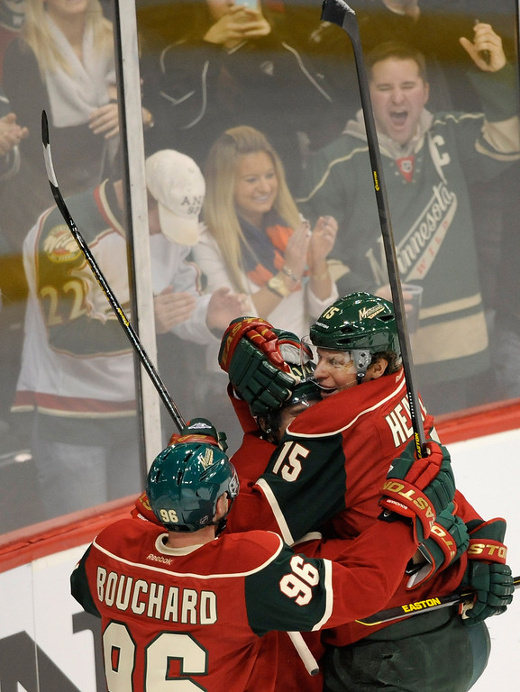 . ST PAUL, MN - JANUARY 19: (L-R) Pierre-Marc Bouchard #96, Zach Parise #11 and Dany Heatley #15 of the Minnesota Wild celebrate a goal against the Colorado Avalanche during the second period of their season opener on January 19, 2013 at Xcel Energy Center in St Paul, Minnesota. (Photo by Hannah Foslien/Getty Images)