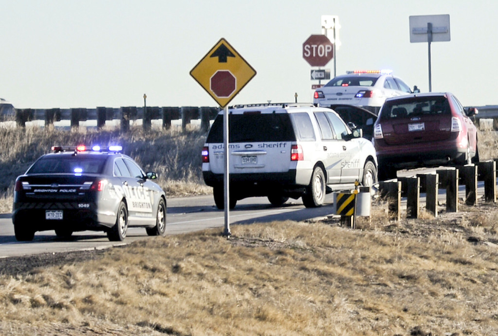 . Brighton Police and Colorado State Patrol cars surround a Ford Edge stolen from Longmont with a 4-year-old boy in it in Brighton, Colorado March 12, 2014.