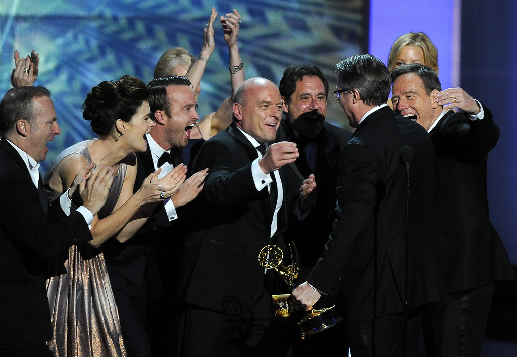 """. The cast of \""""Breaking Bad,\"""" from left, Bob Odenkirk, Betsy Brandt, Aaron Paul, Dean Norris and Bryan Cranston, right, congratulate creator Vince Gilligan, second right, after he accepted the award for outstanding drama series at the 65th Primetime Emmy Awards at Nokia Theatre on Sunday Sept. 22, 2013, in Los Angeles.  (Photo by Chris Pizzello/Invision/AP)"""