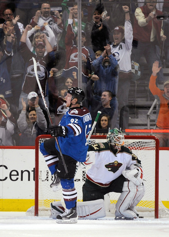 . Colorado Avalanche left wing Gabriel Landeskog (92), from Sweden, celebrates a goal against Minnesota Wild goalie Niklas Backstrom, from Finland, during the second period of an NHL hockey game Saturday, March 16, 2013, in Denver. (AP Photo/Jack Dempsey)