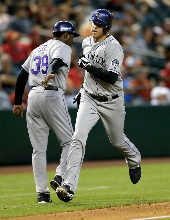 . Colorado Rockies pitcher Jordan Lyles rounds third after hitting a home run against the Arizona Diamondbacks during the third inning of a baseball game on Wednesday, April 30, 2014, in Phoenix. (AP Photo/Matt York)