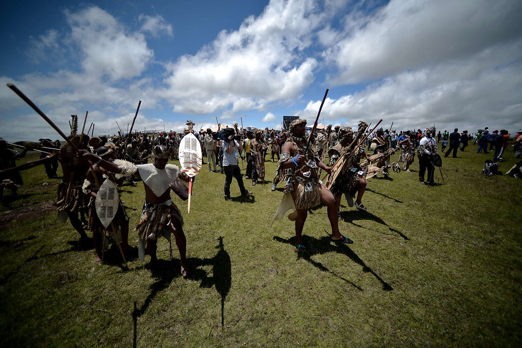 . Xhosa tribe members dance as the coffin of South African former President Nelson Mandela is carried to his burial site during his state funeral in Qunu on December 15, 2013. Mandela, the revered icon of the anti-apartheid struggle in South Africa and one of the towering political figures of the 20th century, died in Johannesburg on December 5 at age 95.     AFP PHOTO / FILIPPO MONTEFORTEFILIPPO MONTEFORTE/AFP/Getty Images
