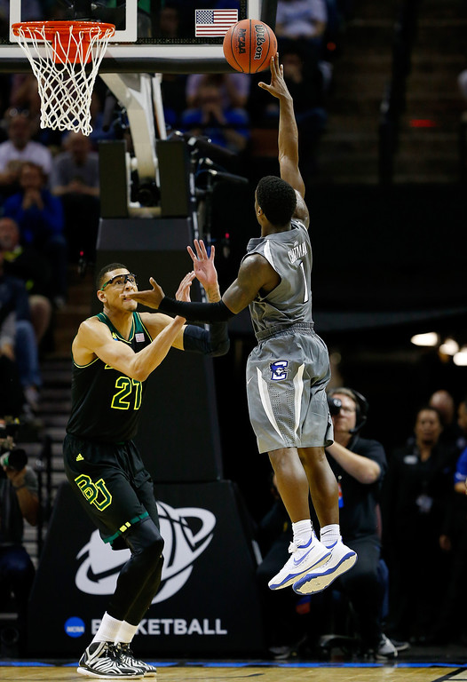 . Austin Chatman #1 of the Creighton Bluejays goes up for a shot as Isaiah Austin #21 of the Baylor Bears defends during the third round of the 2014 NCAA Men\'s Basketball Tournament at the AT&T Center on March 23, 2014 in San Antonio, Texas.  (Photo by Tom Pennington/Getty Images)