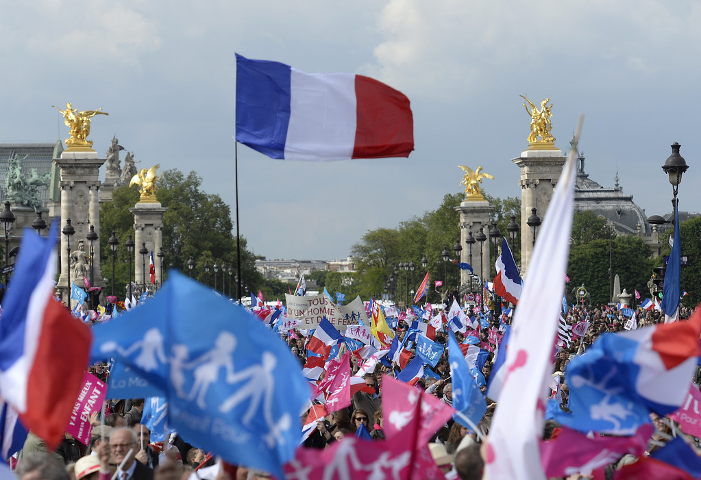 ". Thousands of supporters of the anti-gay marriage movement ""La Manif Pour Tous\"" (Demonstration for all) wave flags as they gather towards the Invalides square in Paris on May 26, 2013 during a mass protest against a gay marriage law. France on May 18 became the 14th country to legalize same-sex marriage after President Francois Hollande signed the measure into law following months of bitter debate and demonstrations. Tens of thousands marched through Paris today to protest a new gay marriage law, with police on high alert amid warnings hardliners could infiltrate the demonstration and cause trouble.   ERIC FEFERBERG/AFP/Getty Images"