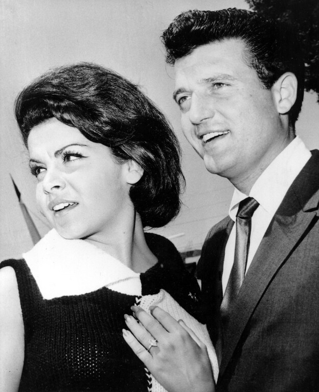 ". Former Mouseketeer Annette Funicello is seen on the set of the Walt Disney production ""Pajama Party,\"" with motion picture agent Jack Gilardi, shortly after the couple announced their plans to marry, in Hollywood, Calif., on August 24, 1964.    (AP Photo)"
